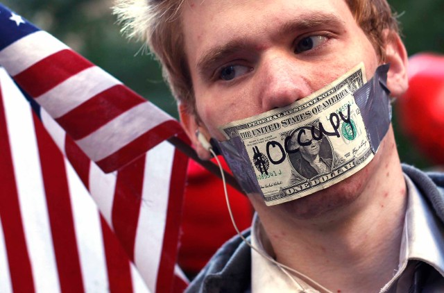 An Occupy Wall Street campaign demonstrator stands in Zuccotti Park, near Wall Street in New York (REUTERS)